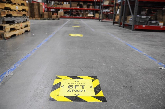 covid protection signs on the floor