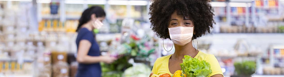 People wearing masks shopping