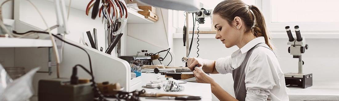 woman workin on jewelry