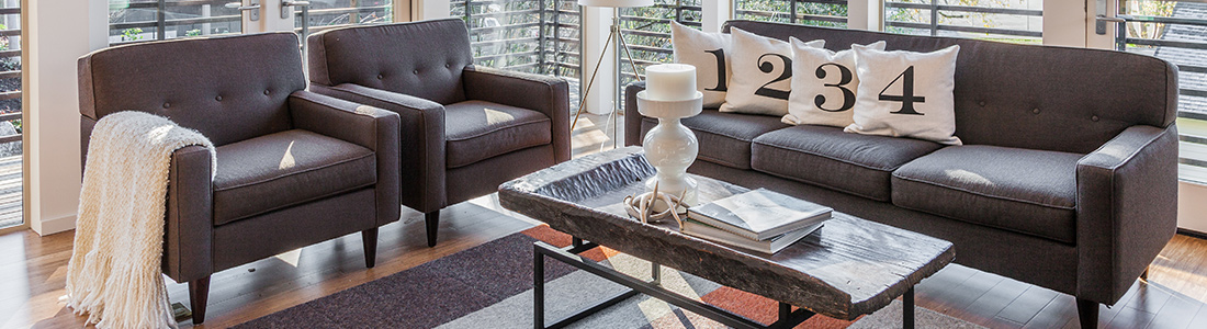 a living room with furniture and decor