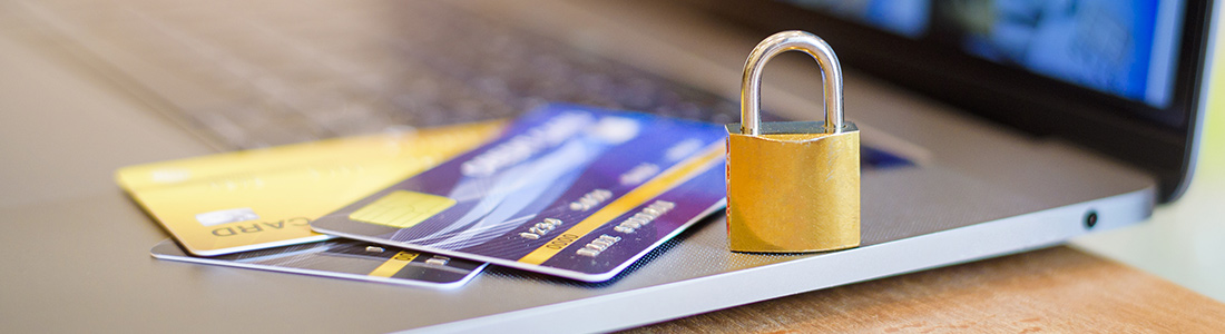credit cards and a padlock on a notebook